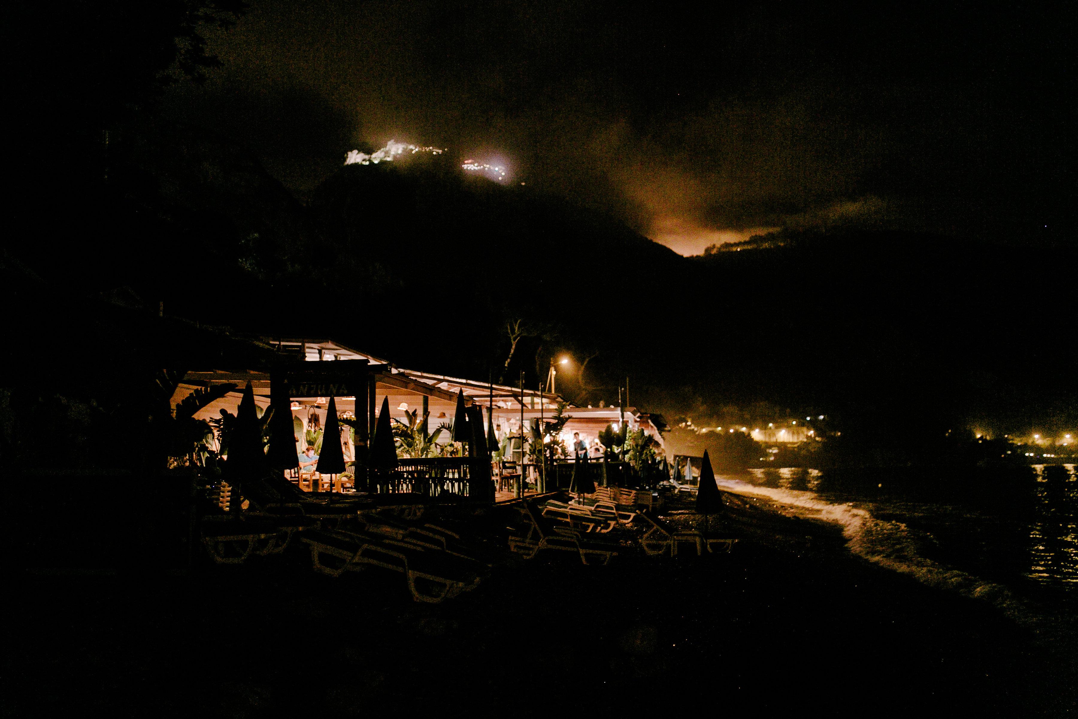 Anjuna, a beach restaurant at night by the Mediterranean Sea.